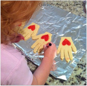 Gifts from the Heart: Helping Hands Heart Cookies- A great edible gift using your little's handprint and artistry at Go Running, Mama!
